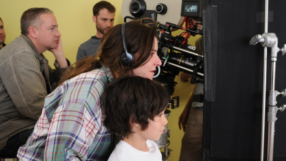 Lynne Ramsay, Jasper Newell and crew on the set of We Need To Talk About Kevin