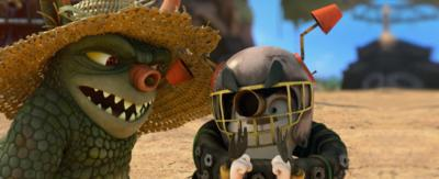 A gumble dressed as a bottersnike in a football helmet and two tyres.