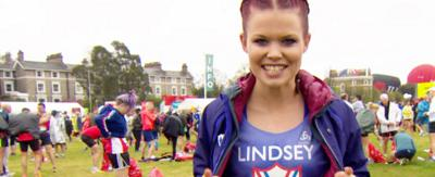 Lindsey before the London Marathon. Her running top has her name and the Sport Badge on it.