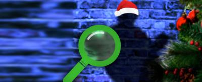 A purple brick wall with Shelley's shadow on it and a large green magnifying glass.