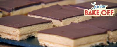 Shortbread peanut butter squares on a slate tray.