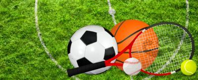 A football, basketball, baseball and tennis ball on a field.