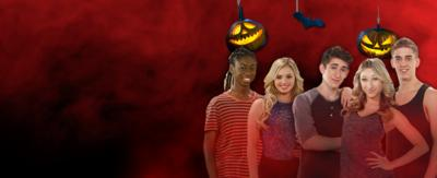 Stars of The Next Step on a spooky red background with Halloween decorations.