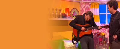 Mark pretends to play the guitar for Jermain Jackman, but it's actually Sam playing.