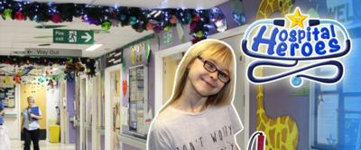 Angharad with the Hospital Heroes logo in a hospital corridor.