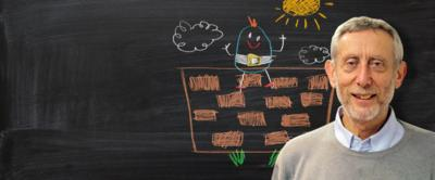 Michael Rosen from Poetry Playtime in front of a blackboard picture of Humpty Dumpty sitting on a wall.