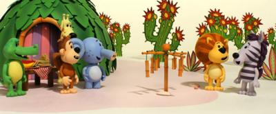 Crocky, Ooo Ooo, Topsy, Huffty, Raa Raa and Zebby standing next to some wind chimes, surrounded by a hut and some cacti.