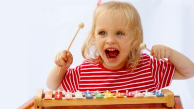 How will learning a musical instrument help my child