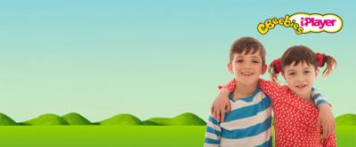 Topsy and Tim in front of CBeebies hills.