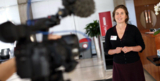 Woman in front of camera at BBC Cymru Wales Expert Women's Day