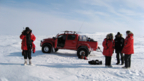 Topgear image, car and people pictured on snowy landscape