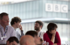 people with BBC in background