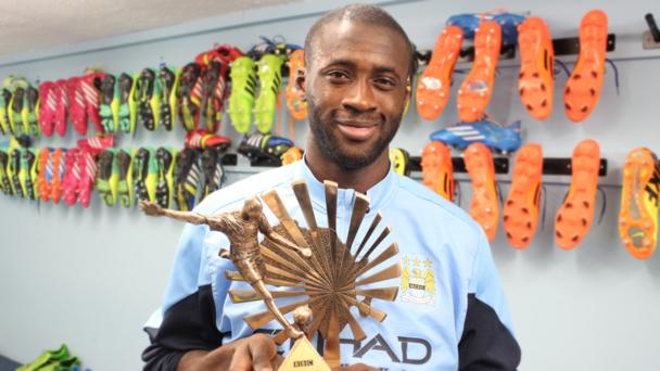 Yaya Toure holding the 2013 BBC African Footballer of the Year Award