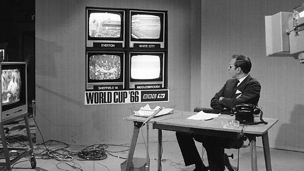 World Cup Report anchor David Coleman takes in four live games at once in the BBC TV studios during the 1966 World Cup
