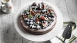 Baked cheesecake with blackberries, blueberries and  figs