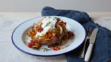 Baked sweet potato with roasted vegetables and bulgur wheat