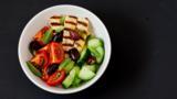 Halloumi, tomato, cucumber and couscous grain bowl