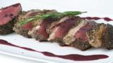 Peppered loin of venison with red wine sauce