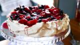 Spiced pavlova with plums and cherries