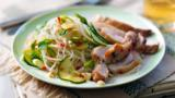 Spicy chicken thighs with cucumber and cashew salad