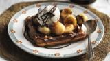 Waffles with hot chocolate sauce, fried bananas and ice cream