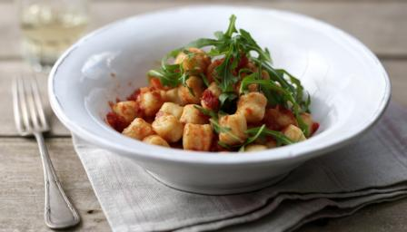 Basil gnocchi with simple tomato sauce and wild rocket