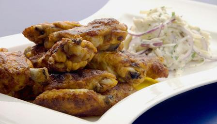 Buffalo wings with apple and celeriac slaw
