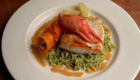 Butter roasted halibut, lobster salad, coriander pasta and a passion fruit sauce