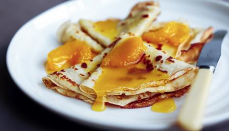 Crpes with orange butter sauce