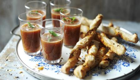 Gazpacho shots with pimenton and caraway seed twists