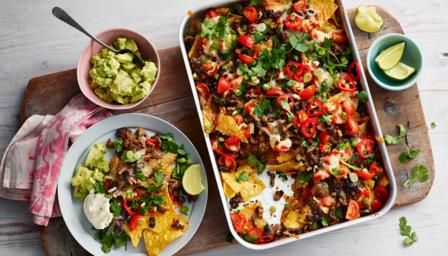 doesn't love a pile of nachos with all the fixings? Tailor it to