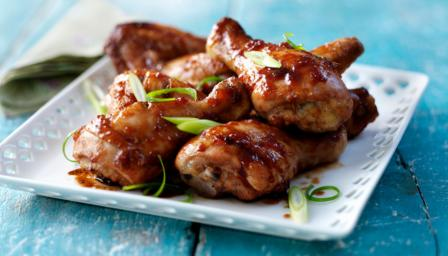 Sticky barbecue chicken wings and drumsticks