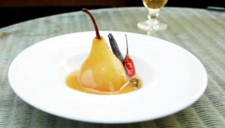 Pears poached in cardamom, cinnamon and chilli syrup with salted caramel sauce