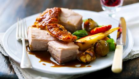 Roast belly of pork with root vegetables