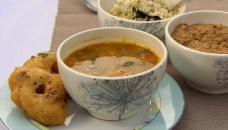 Sambhar vada: yellow lentil soup with spiced doughnuts