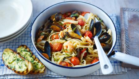 Seafood pasta with garlic bread