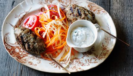 Turkish kofta kebabs with minted yoghurt and kohlrabi and carrot salad