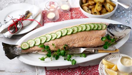 Whole poached salmon and lemon