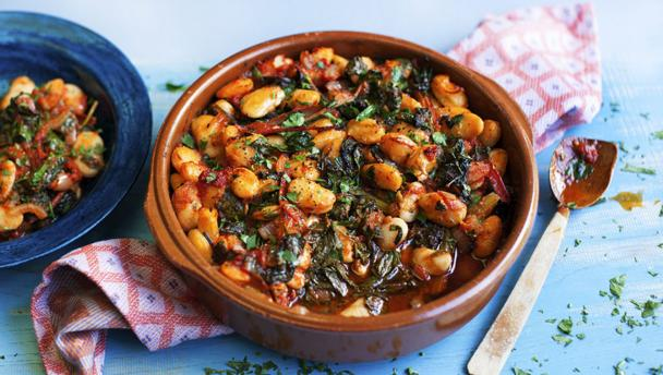 Gigantes with tomatoes and greens