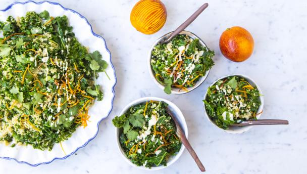 Kale and quinoa sauté with orange tahini dressing