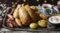 Roast chicken with sausage and bacon rolls, bread sauce and gravy-roasted potatoes