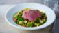 Roast loin of lamb, peas, lettuce and bacon