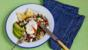 Black bean and brown rice bowl with poached eggs
