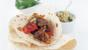 Lamb with hummus and tortillas