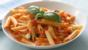 Pasta with tomato sauce, mozzarella and basil