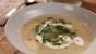 Potato soup with soured cream and chives