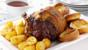 Roast beef with Yorkshire puddings, roast potatoes and gravy