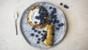 Rolled lemon pancakes with blueberries and yoghurt