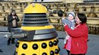Mum Claire Handy with her baby meets a Yellow Dalek
