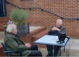 Des and Christopher preparing to record, on the terrace at The Queen's Club